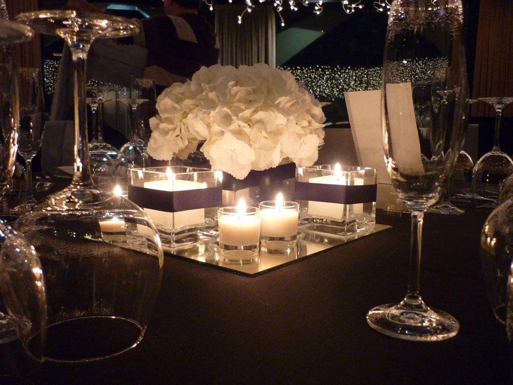 Centro de mesa con cubos de espejo y cristal para un