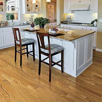 Combination Of Clear Coated Red Oak Floors Against Painted White Cabinets Brightens This Vintage