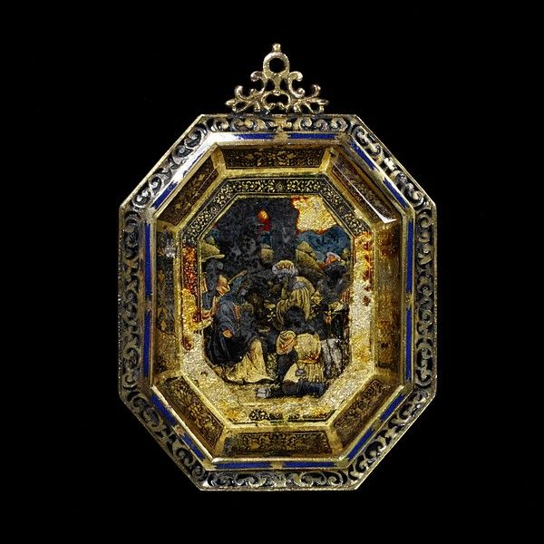 Rock crystal plaque mounted in enamelled brass, set with a panel of verre eglomisé repesenting the Adoration of the Magi, the setting Spanish