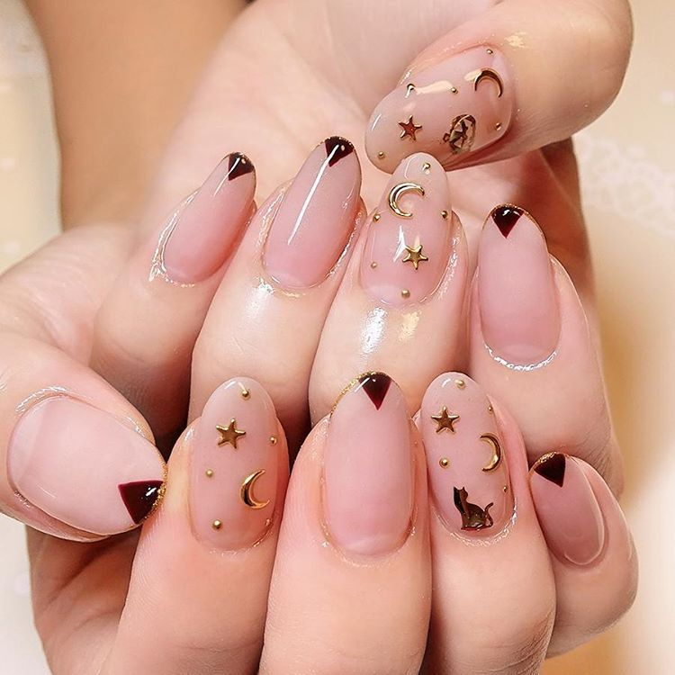 These Moon And Star Nails Are So Cute I Love That They Are Natural Looking But Still Have Something To Make Them Stand Moon Nails Star Nail Designs Star Nails