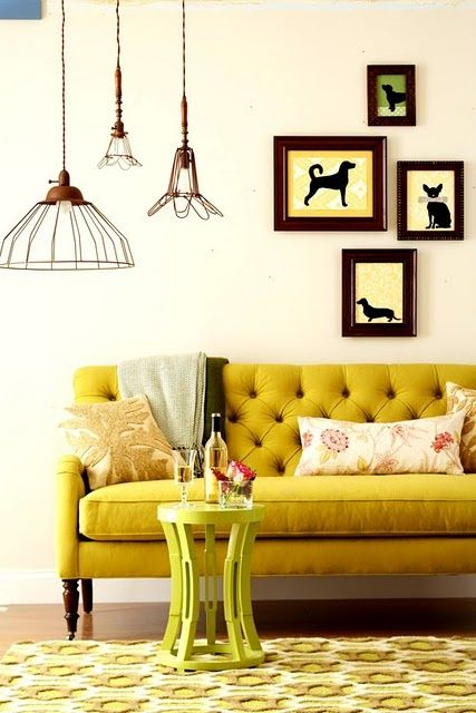 Stunning Vintage Style Couch Paired With Industrial Pendant Lighting.  Repetition Of Design Elements: Yellows, Dog Silhouettes, Cage Light  Pendants.