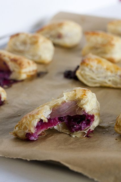 Blackberry Mascarpone Turnovers  Makes 24 turnovers    2 7-ounce prepared puff pastry sheets  6 ounces blackberries, chopped  1/4 cup Mascarpone cheese  zest of 1 lemon or orange  1 tablespoon honey  1 egg, beaten