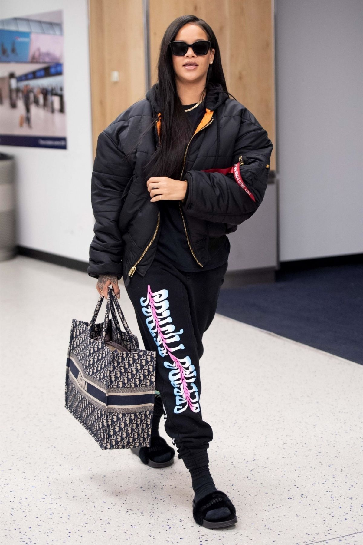 263a871b09e2 Rihanna wearing Off-White Angel and Blue Swallow Sweatpants