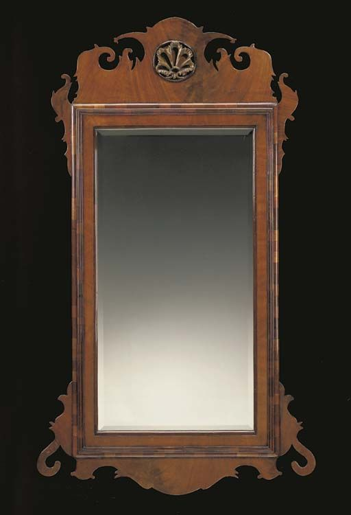 A GEORGE II STYLE MAHOGANY AND PARCEL-GILT MIRROR
