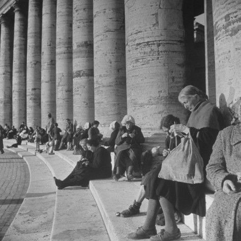 Italian Women Knitting While They Socialize in the Colonade of St. Peter's Square, Vatican City    by Margaret Bourke-White