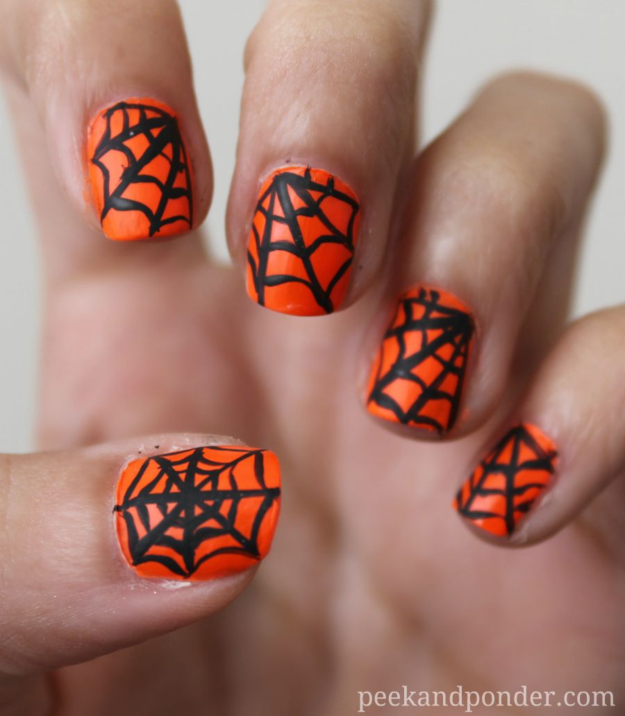 Love this spooky spiderweb manicure for Halloween! ~Renee