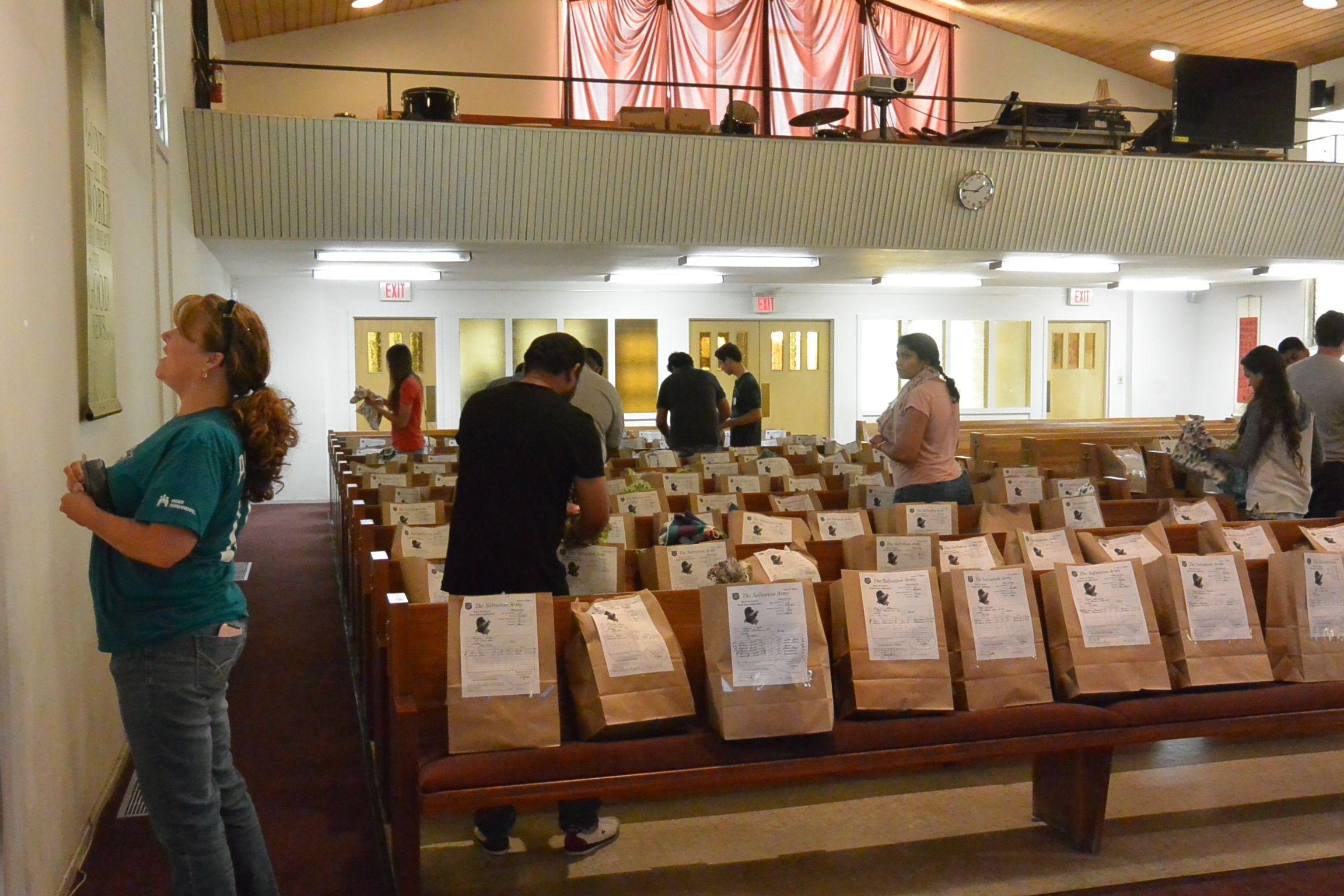 Volunteers pack Back to School backpacks for kid in need