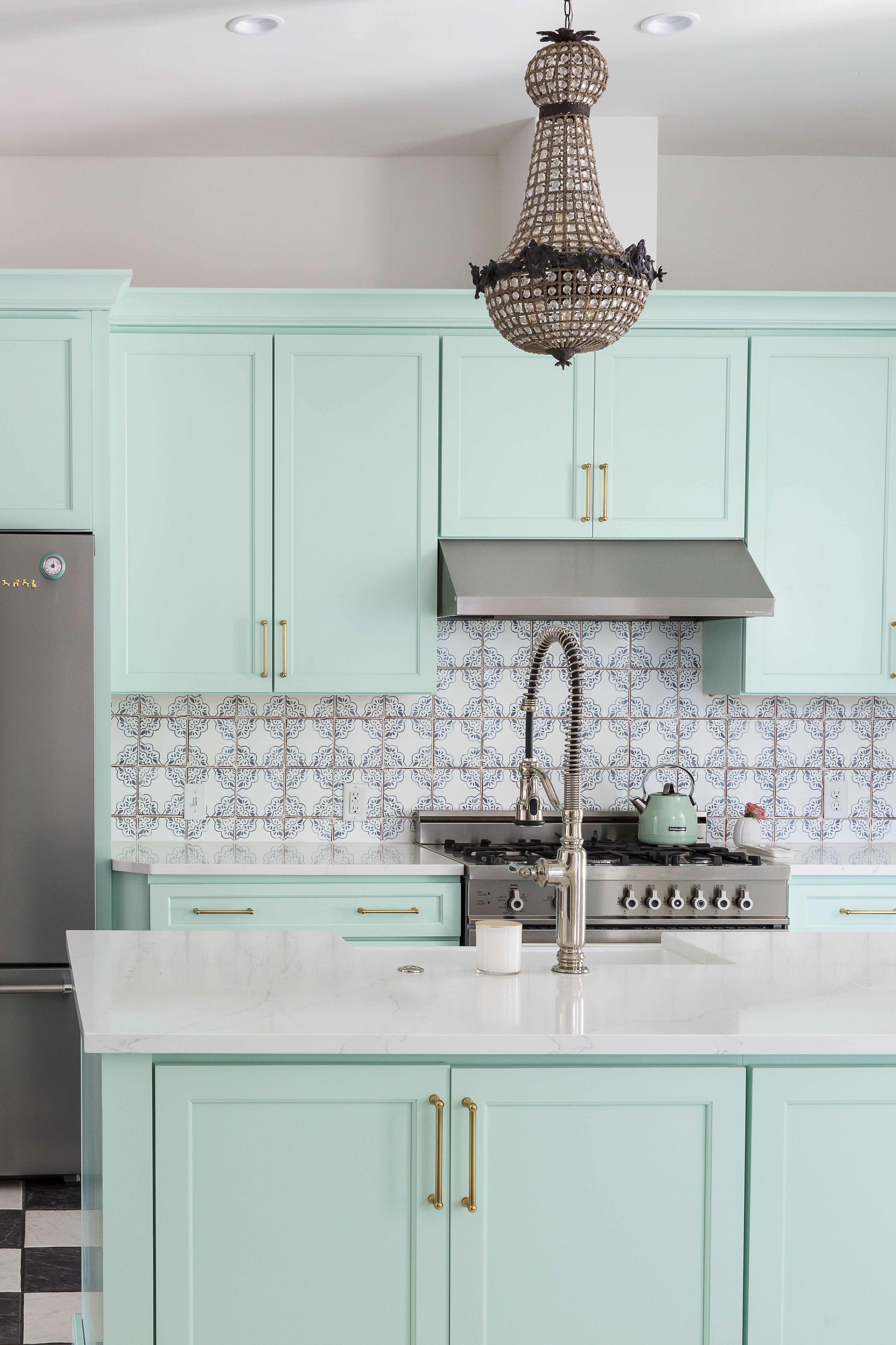 A Mint Green Kitchen with Brass Hardware and Moroccan