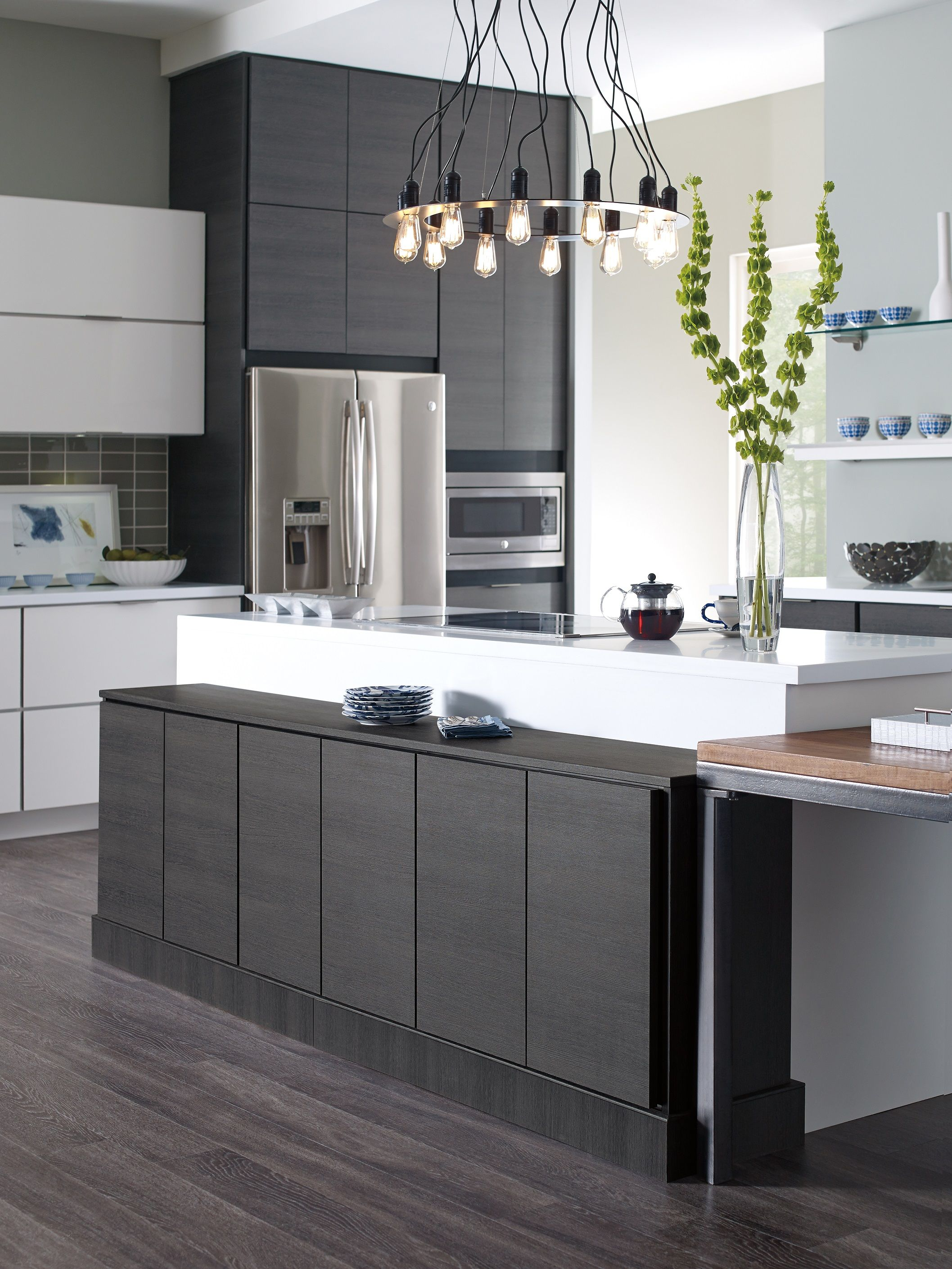 Doors and drawers adobe contemporary style flat panel cabinet door - The Sleek Laminate Cabinets In This Contemporary Kitchen Feature Slab Doors Dramatically Contrasting Finishes And Decidedly Modern Accents
