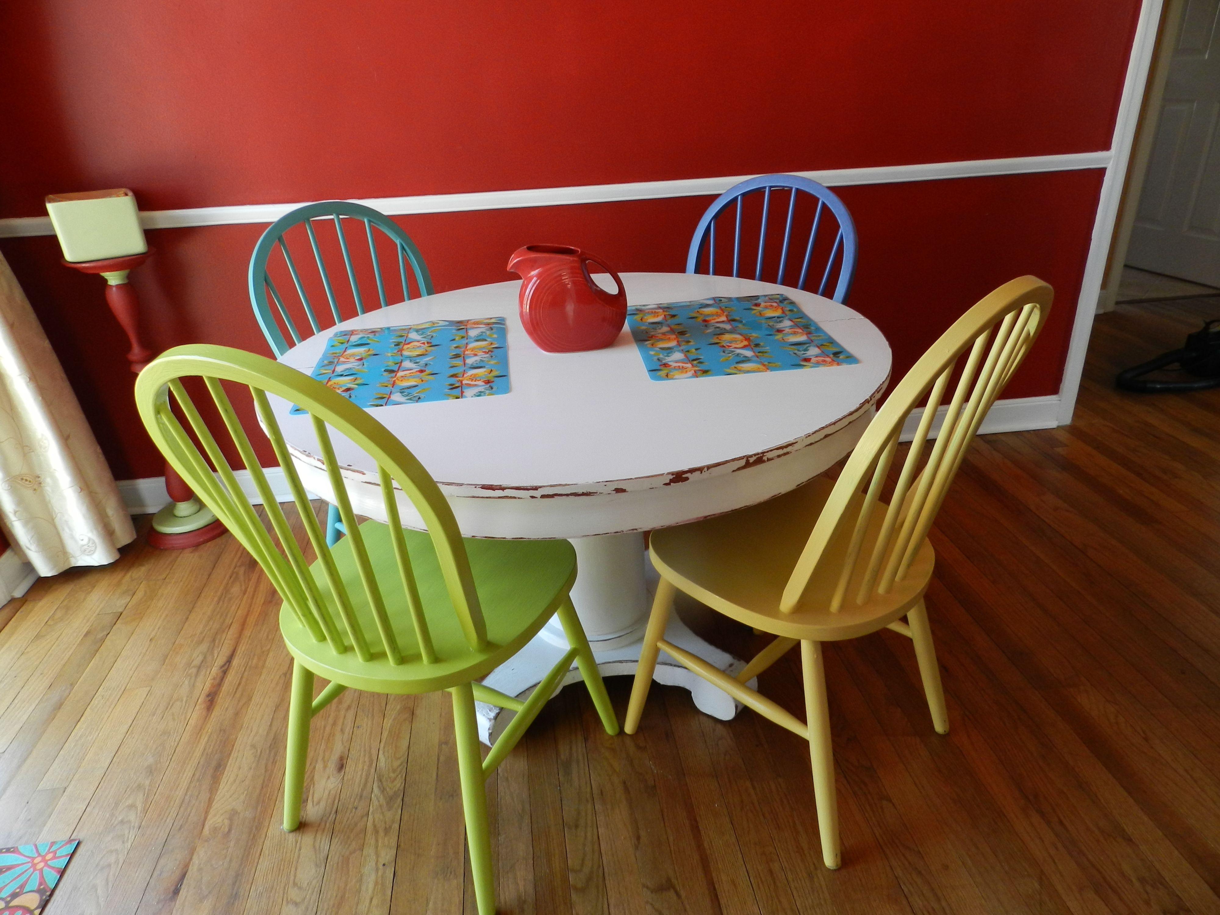 Colorful painted chairs multicolored chairs kitchen for Yellow farmhouse table