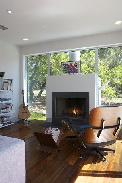 Fireplace, floor to ceiling windows. I can see this working well with a wintery Chicago day. Enjoy the snow while cozying up to the fireplace.