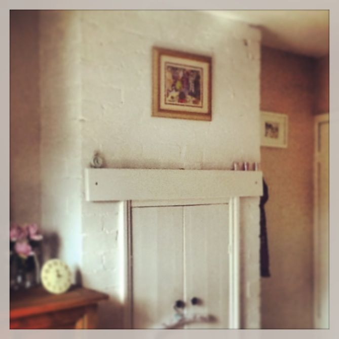 Bedroom old fireplace turned into linen cupboard Graham and