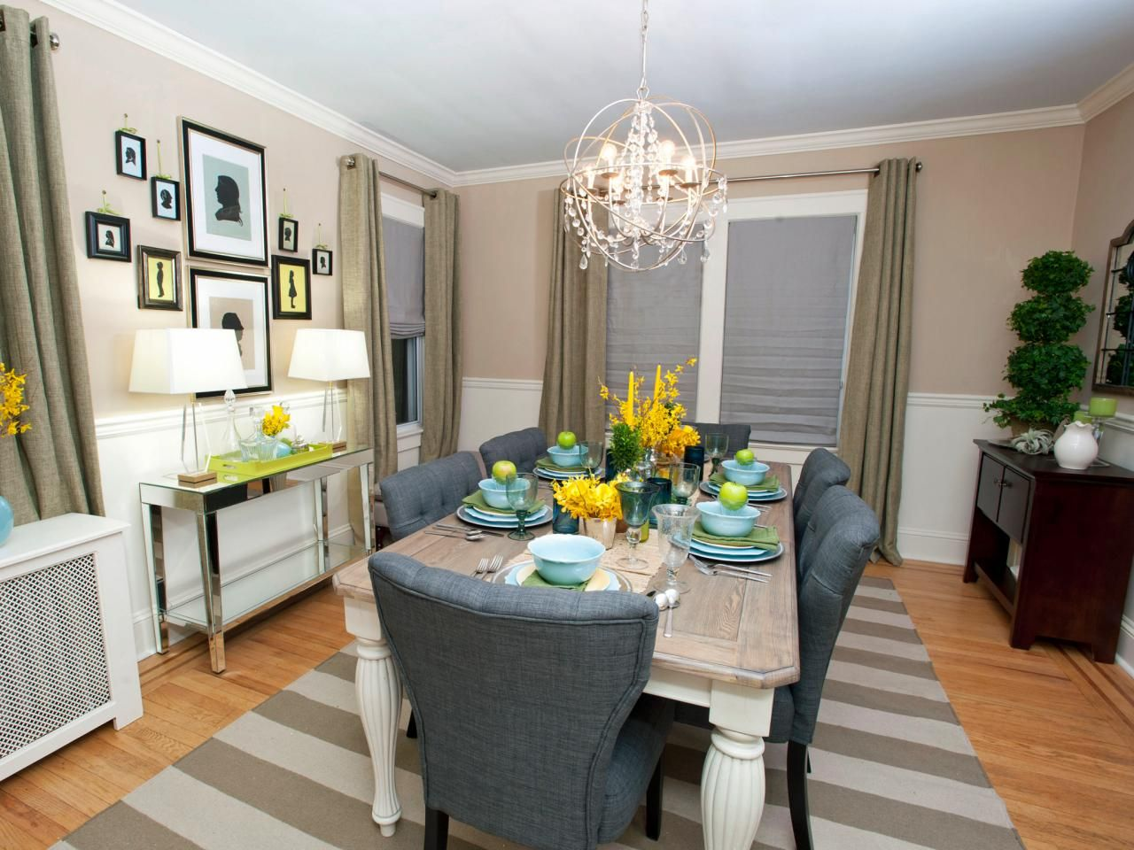 An Updated Taupe Dining Room Boasts Eye Catching Crystal Chandelier