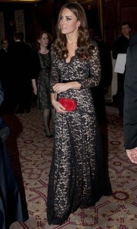 Catherine in lace with red Alexander McQueen's clutch.