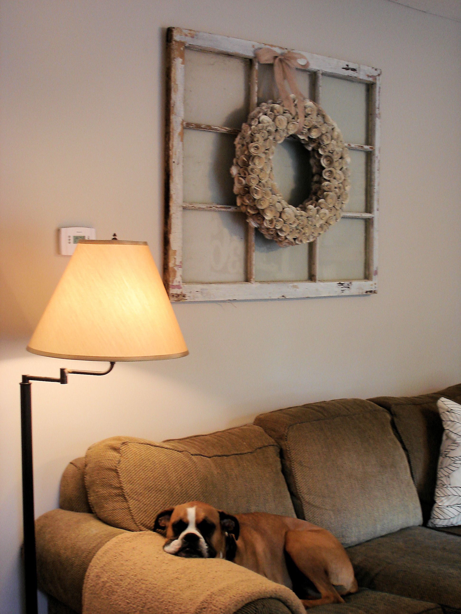 Above window decor  old window and wreath combo love it and think of all the