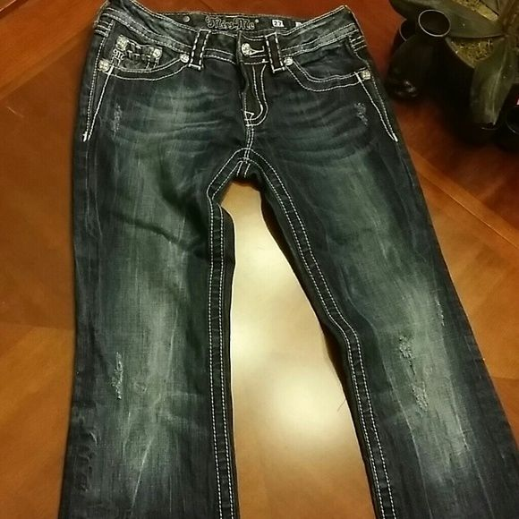 "Miss Me jeans Dark wash blue pics look almost black,  lightly distressed jeans. Professionally altered to 30"" in lenght. Miss Me Jeans"
