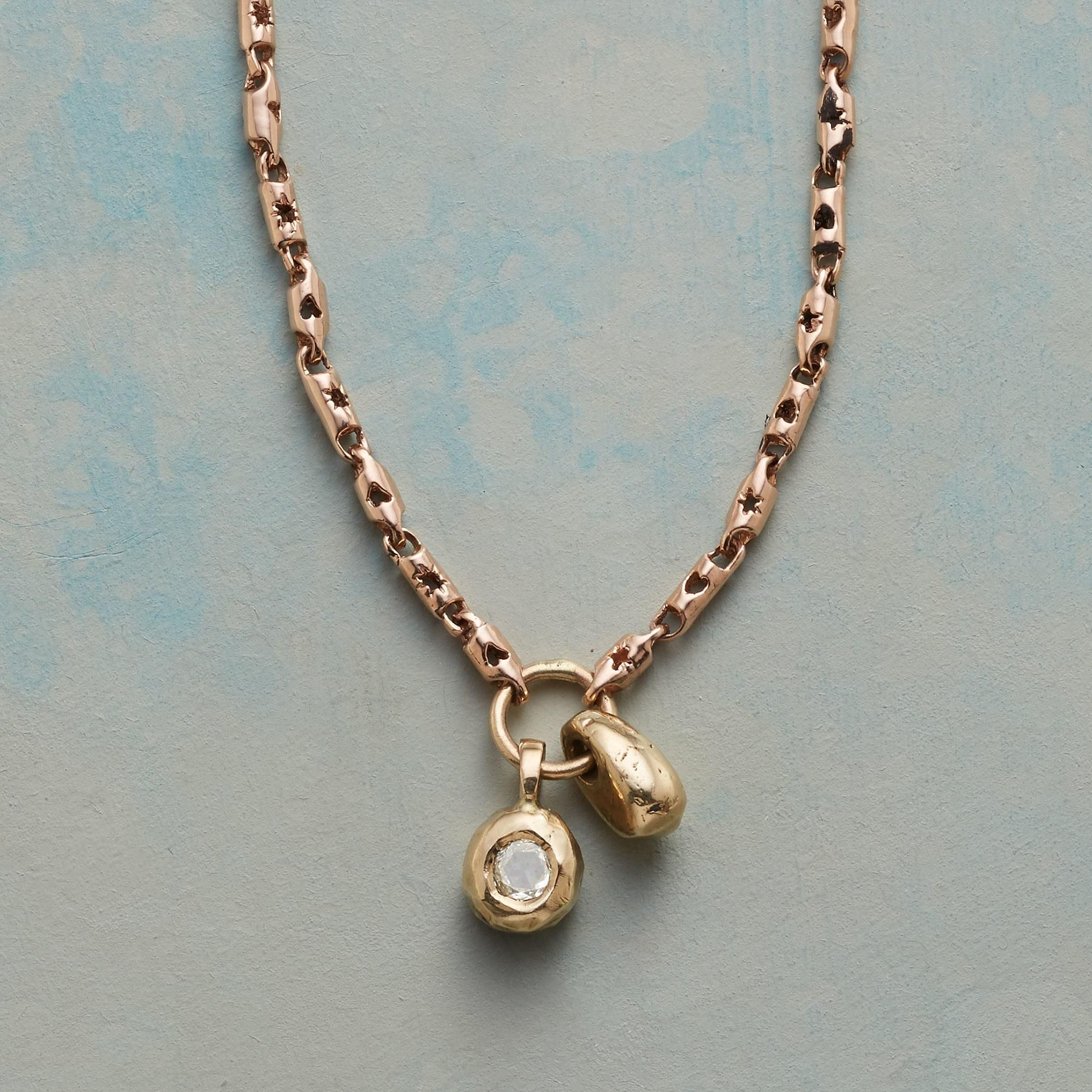 Touchstone diamond necklace handcast links of kt rose gold bear