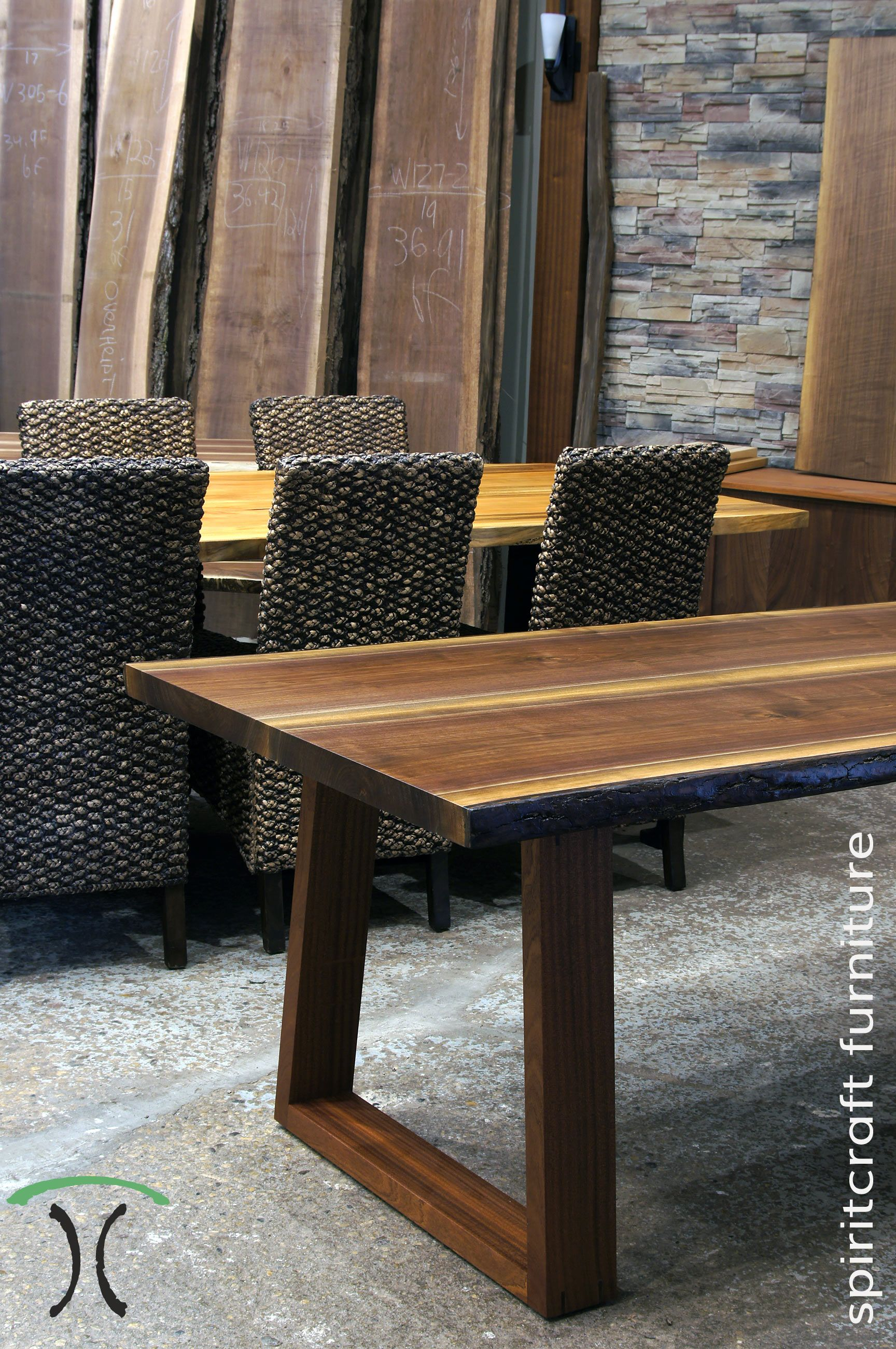 Live edge dining and conference tables in solid black walnut and sycamore with live edge kiln dried slabs on hardwood and cast iron legs on display at our