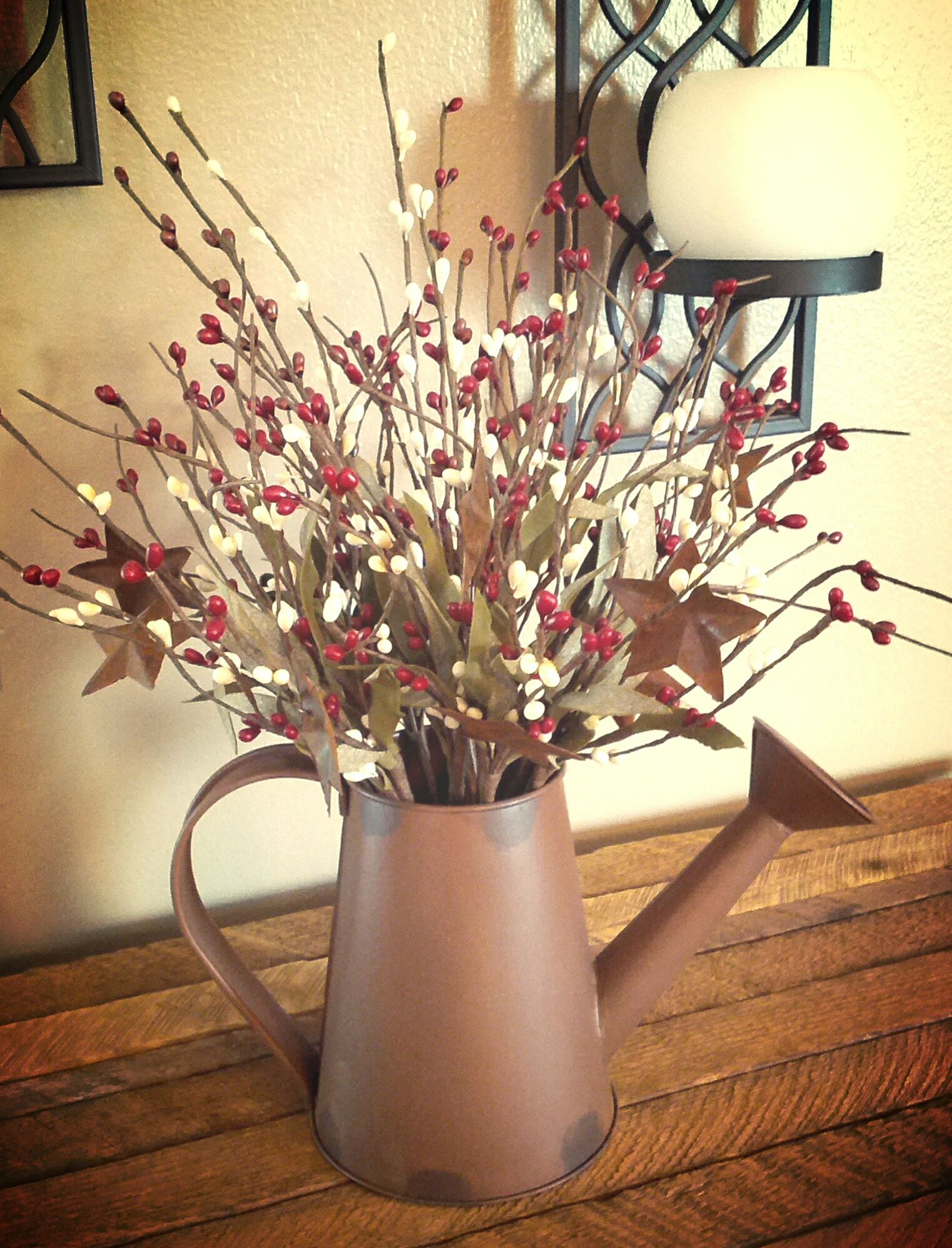 We bought this watering can at a local craft store and filled it with pip berry picks.