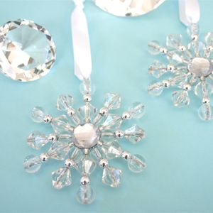 Beaded Snowflake Ornaments-possibly make yourself like we did at daycare and leave one at each setting