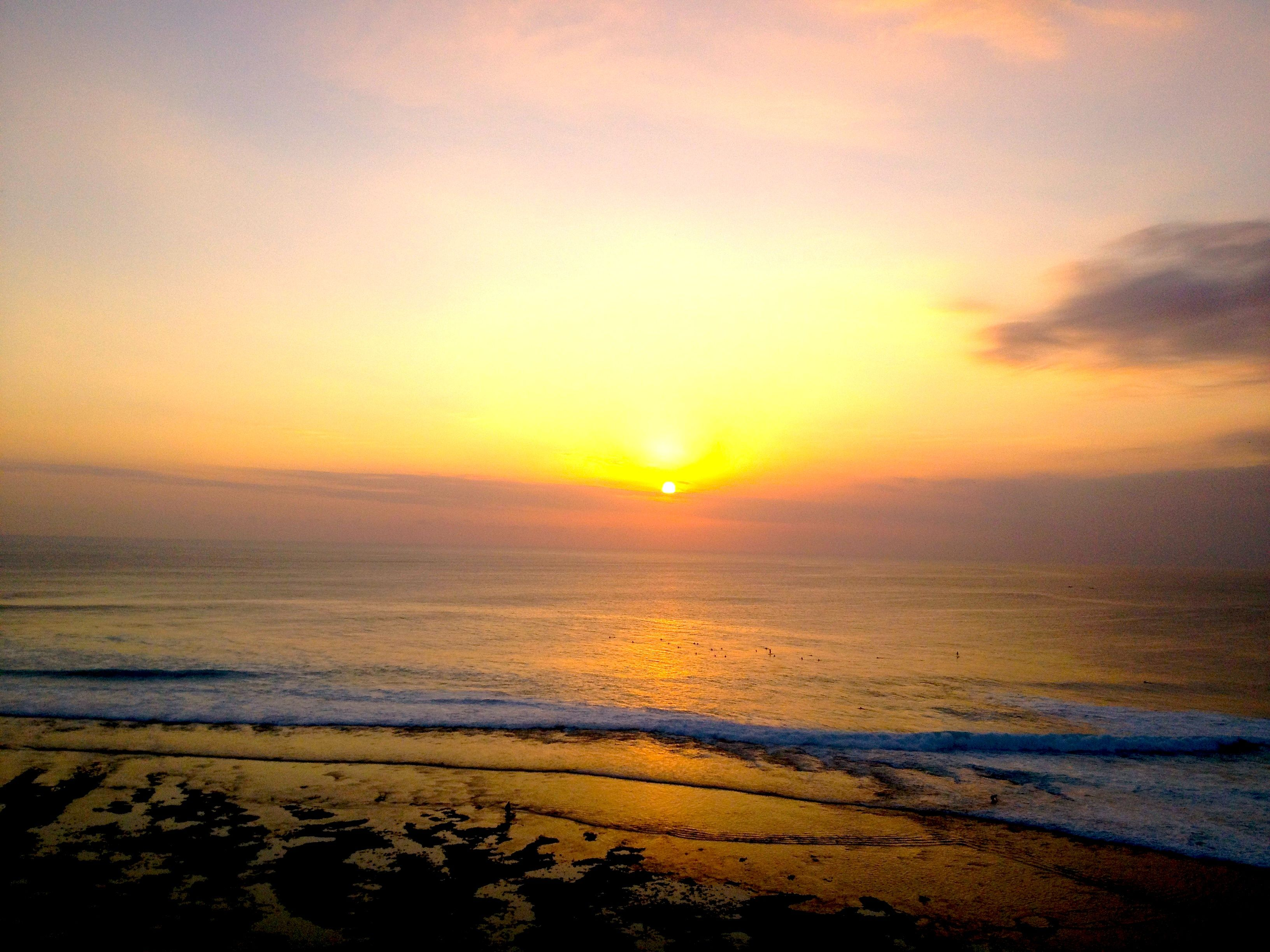 Surfers at Sunset in Uluwatu Bali - the ultimate paradise for catching waves