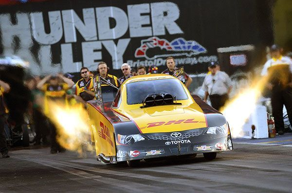 Great Flames Up Photo Of The Dhl Toyota Camry Funny Car In Bristol