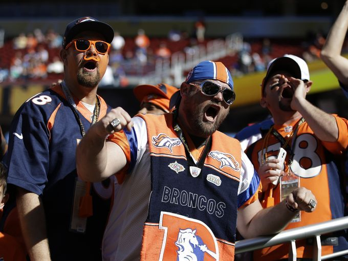 Denver Broncos fans cheer during warm ups before the