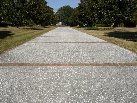 Oyster Shell Concrete Driveway With Brick Paver Apron Borders And