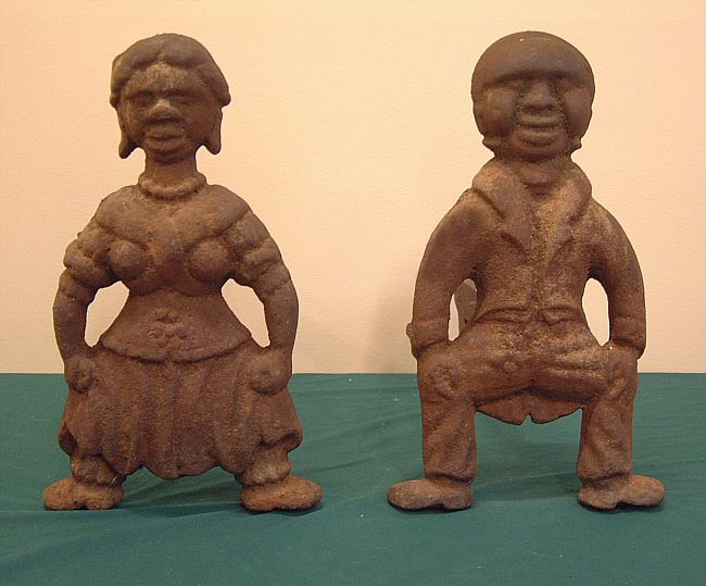 """""""Pair of important Black American Folk Art cast iron andirons, found in an estate in Georgia. Each andiron measures 15 inches deep,13 and three quarters high and 9 and one half inches across the base. We believe they are post 1852 which is when Harriet Beecher Stowe published Uncle Toms Cabin which sold millions of copies and created many black collectibles at that time."""""""