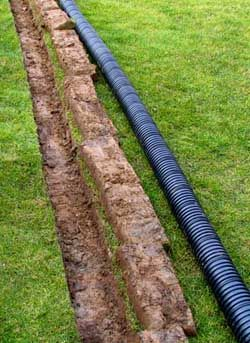 French drain solution to a flooded yard calfinder for Drain pipe landscaping