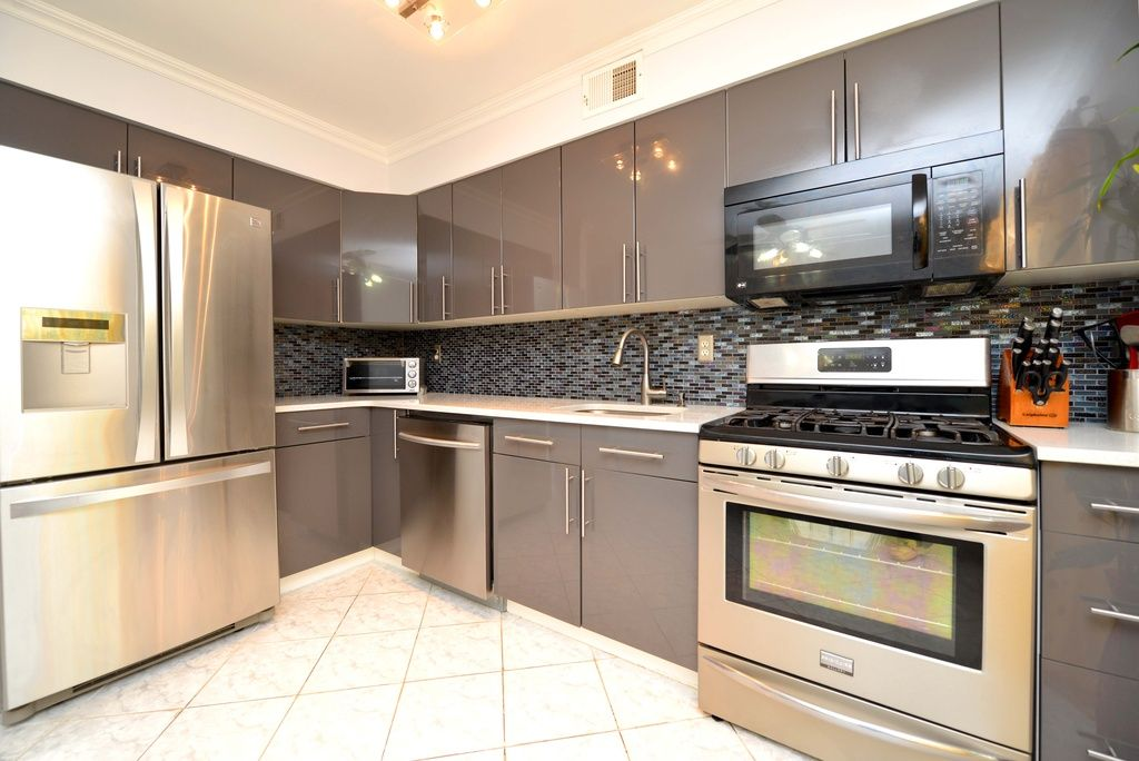 Modern Kitchen With Limestone Counters European Cabinets Dura