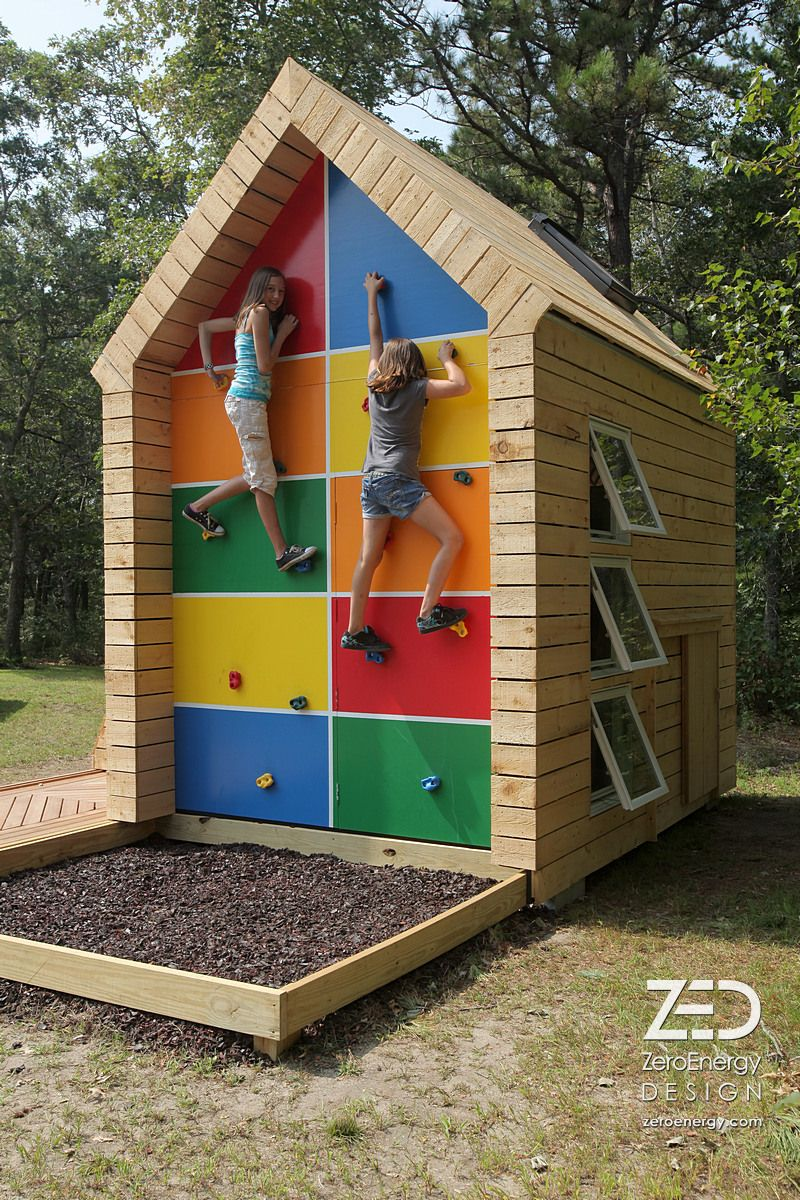 Green esCAPE Playhouse-Cape Cod, MA. One gable end includes a climbing wall, recycled tires for a soft falling surface, and a hidden door that leads inside. Zeroenergy.com
