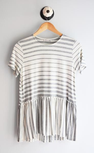 The perfect basic peplum for your closet. Short sleeve peplum tee with heather grey stripes and ivory contrast. Super soft & comfortable. Fits true to size. 96% Rayon, 4% Spandex Handwash