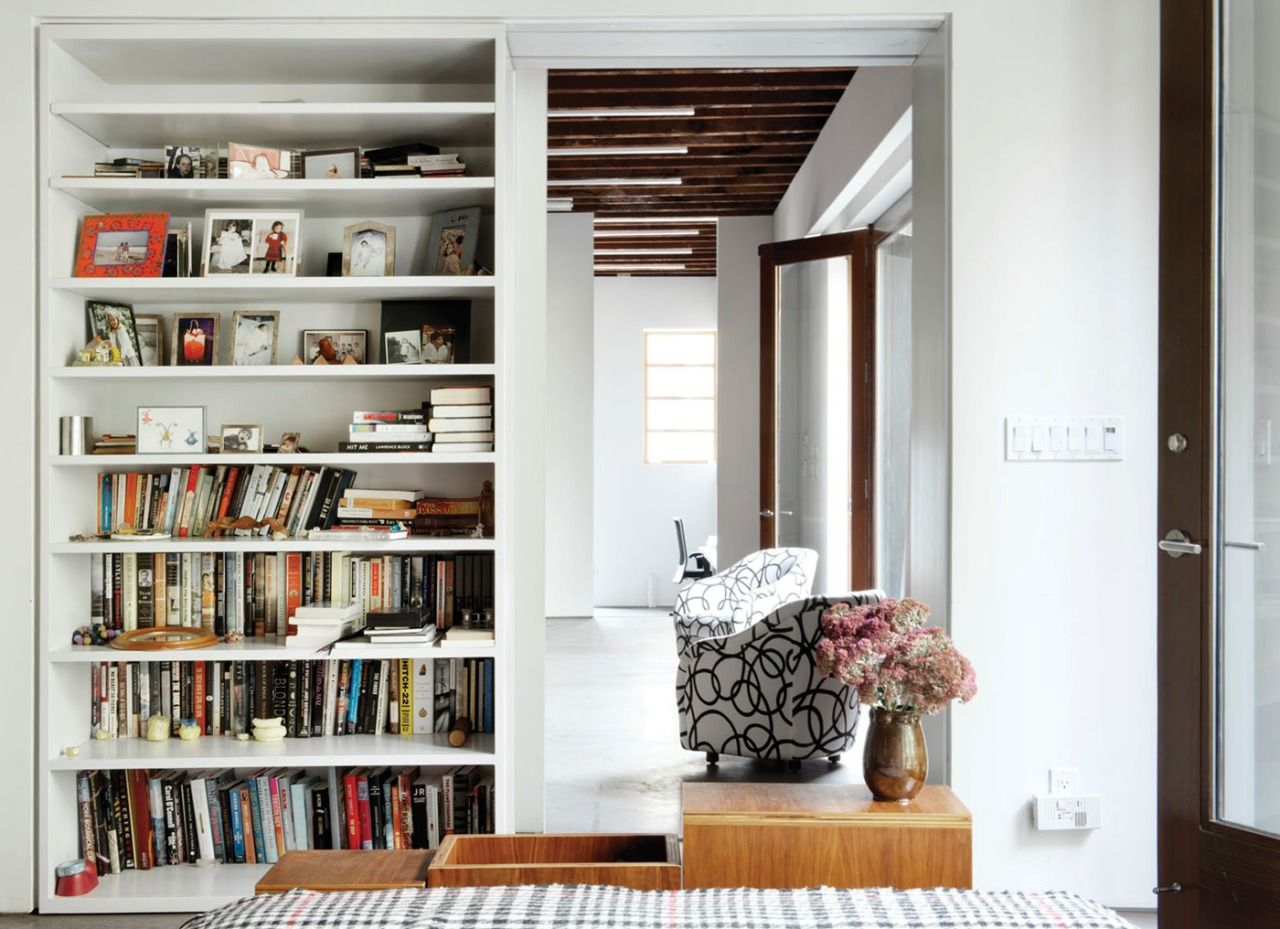 Great A Heavy Bookshelf On Rollers Can Slide Across To Separate The Bedroom From  The Downstairs Studio