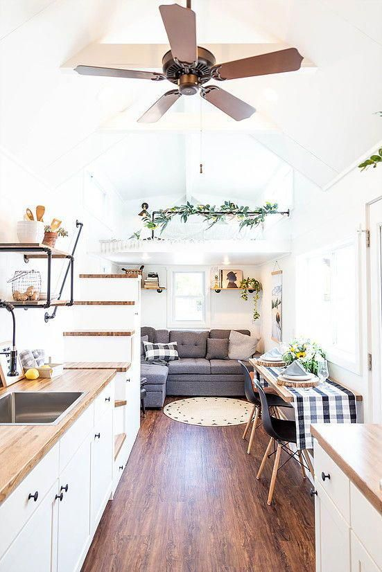 The Living Room Is Located Under The Bedroom Loft And Has Room For A Large Couch The Couch Shown In Th Tiny House Living Tiny House Design Tiny House Interior #tiny #house #living #room #ideas
