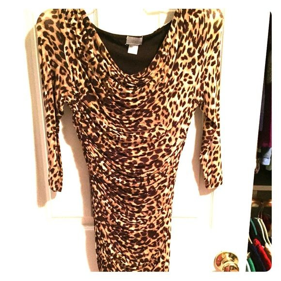 H&M leopard above the knee length dress Super cute H&M just above the knee cotton leopard print dress. Long sleeves. Tight fitting but has ribbing in the right places so it's very flattering and does not look super tight. Size is 8 but I'm usually a 6, and fits well! Never worn H&M Dresses Long Sleeve