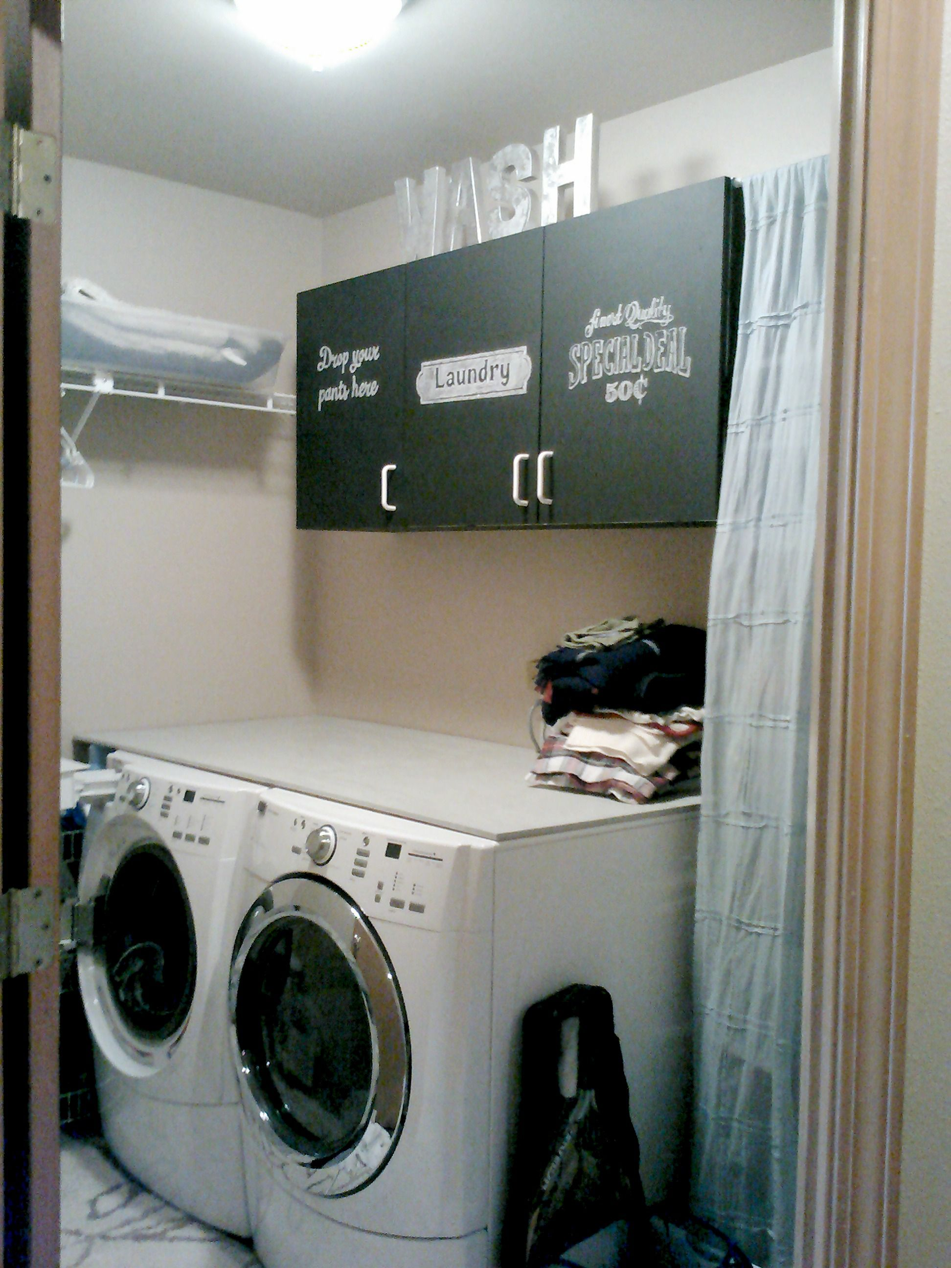 Laundry room: the wooden board above the washer/dryer adds so much more room!