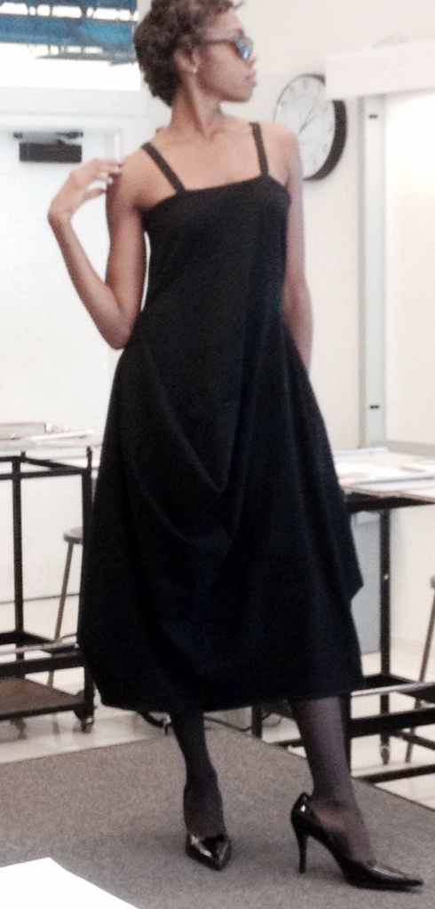 "Model Leilani Drakeford modeling edgy classic ""little black dress"" with a twist, for designer at Parsons."