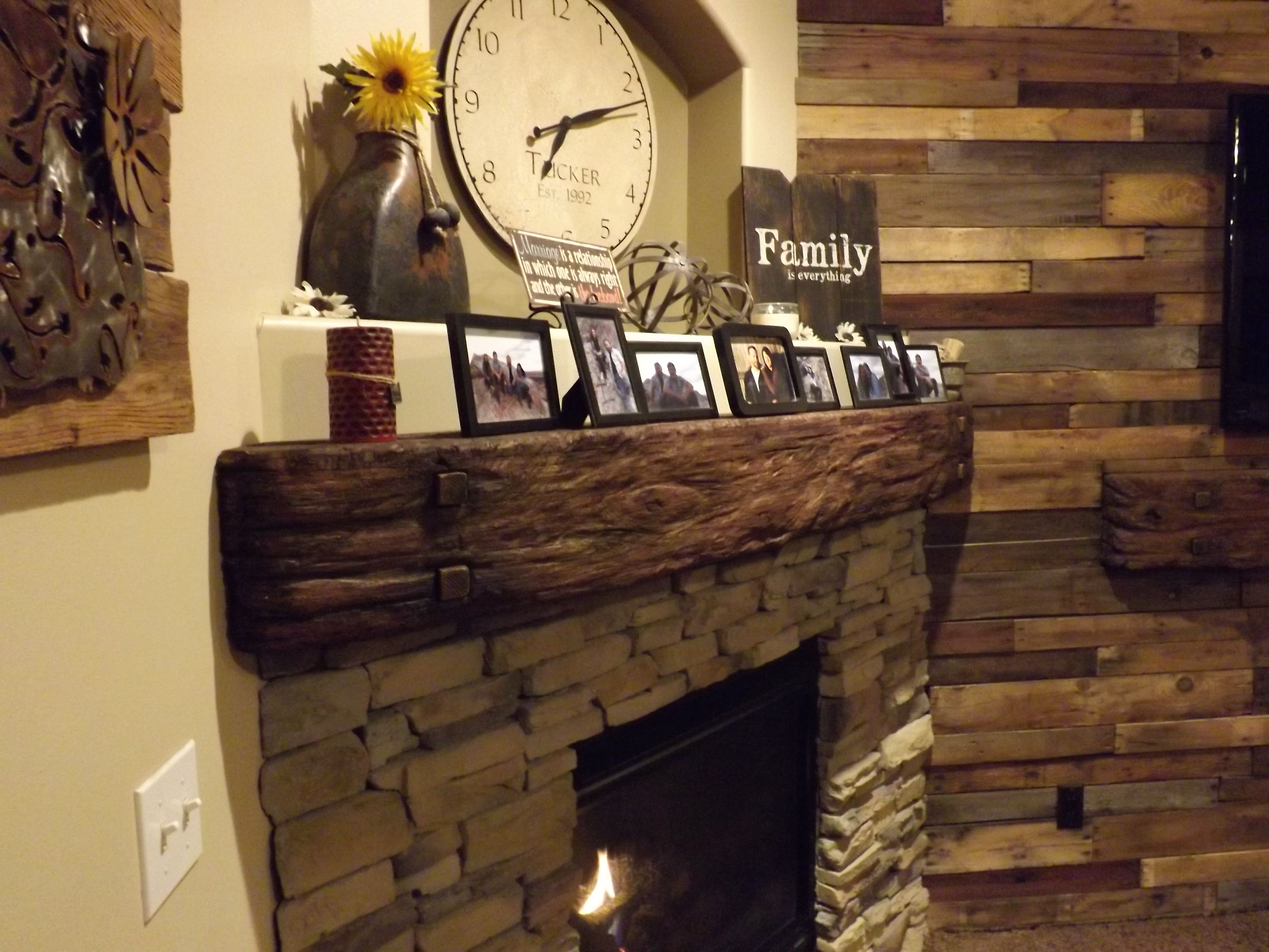 Stone fireplace with reclaimed bargeboard finish contemporary - Rustic Beam Style Mantel Over Stone Surround Blended Into A Pallet Wood Wall For Tv