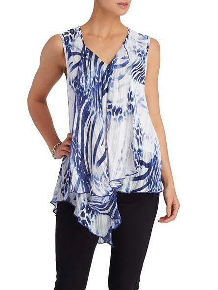 A ruffled trim lends an airy feel to Jolibel's sleeveless blouse. Pair this with slim leg pants and a polished blazer. Pull-on style Imported 3010336-0671