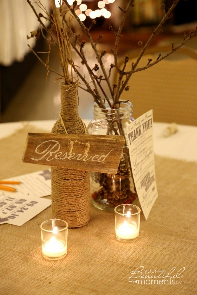 Country wedding table decorations twine wrapped wine for Wedding table decorations with wine bottles