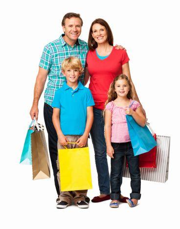 Imagen libre de derechos: Family Standing With Shopping Bags ...