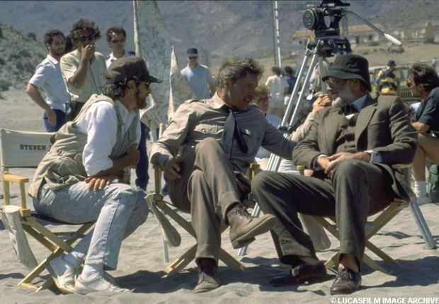 Steven Spielberg, Harrison Ford, and Sean Connery take a break during the filming of Indiana Jones and the Last Crusade.