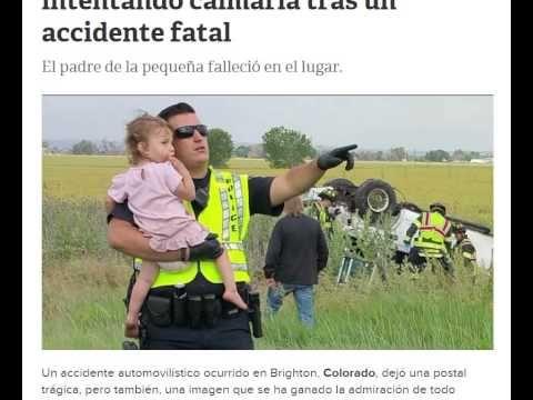 Un policía le canta a una bebé para calmarla tras un accidente fatal
