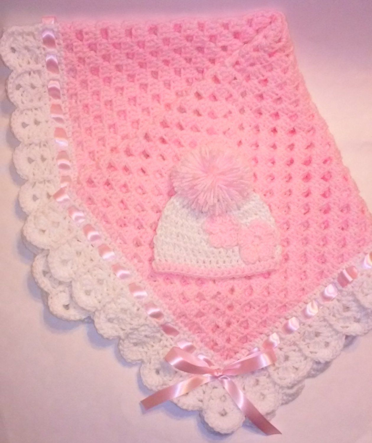Very soft and cuddly pink granny square blanket with white crocheted ...