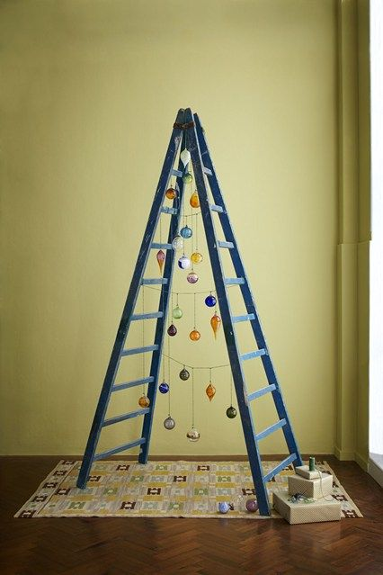 As an alternative to the traditional tree this vintage step ladder is hung with hand-blown glass baubles - Christmas Tree Decorating Ideas (houseandgarden.co.uk)