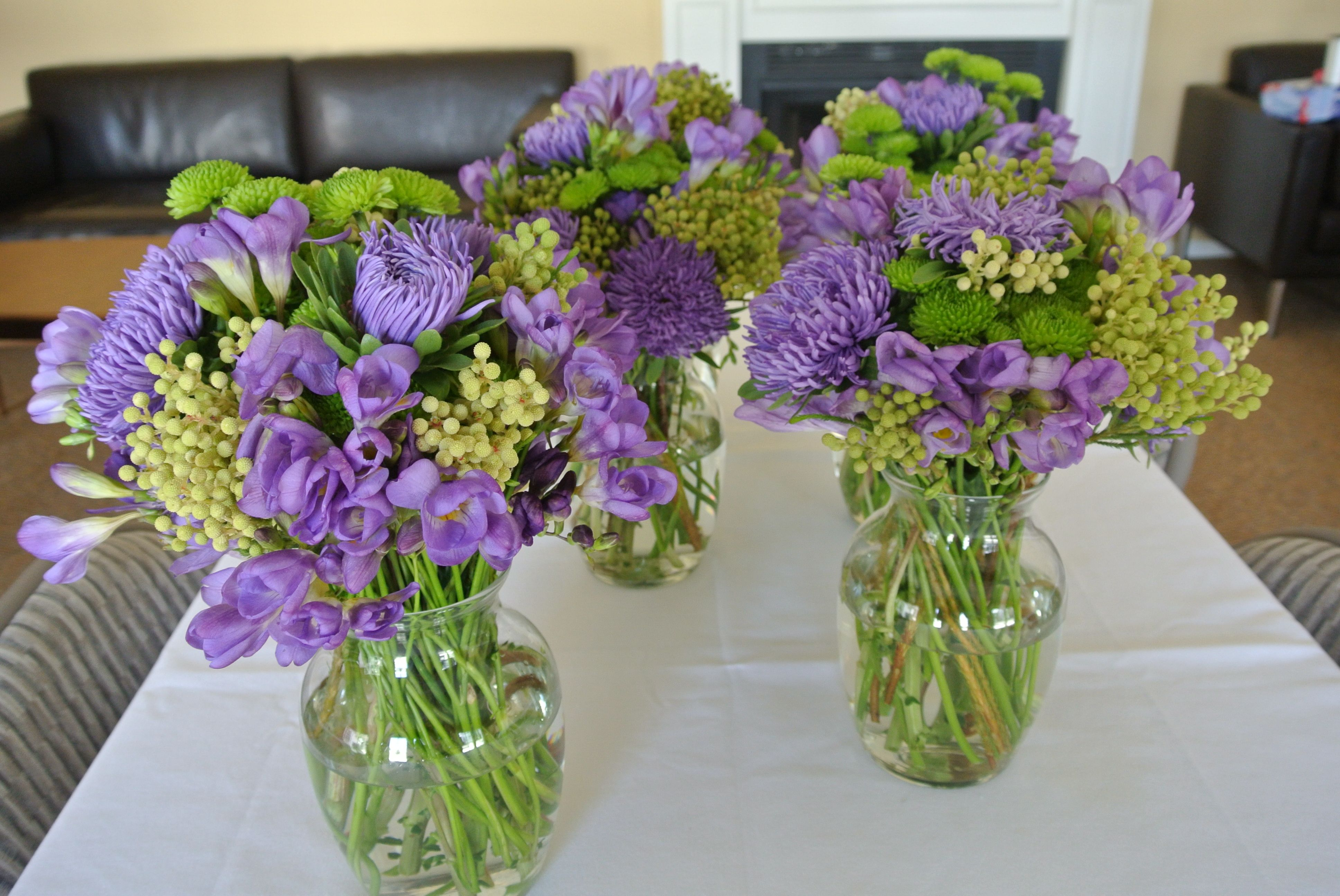 Purple And Green Flower Arrangements Lining The Fairy Table