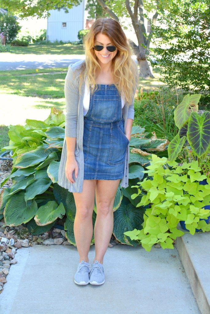 Ashley from LSR in an overall dress, gray cardigan, and gray Nike Juvenate…