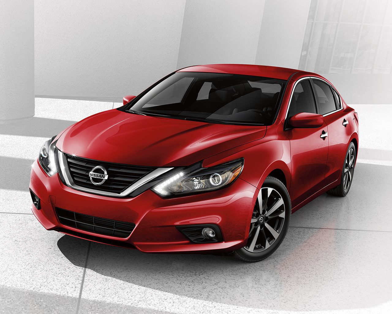 2017 nissan altima sedan front side view shown in cayenne red with v