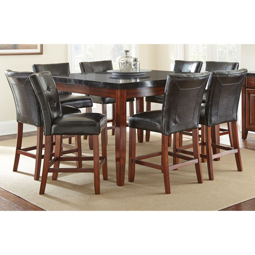 Give your dining room a modern look with this Bailey counter-height dining set. This dining room set features black upholstery that complements the medium-cherry finish of the wood. This warm color combo blends into your home decor with ease.